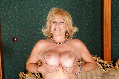 Busty established in nylons striptease off her dress and underclothes