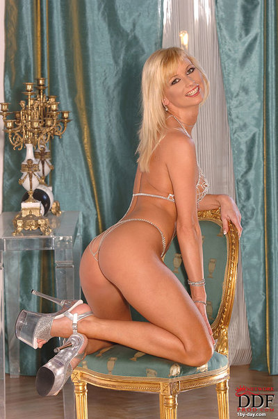 Leggy golden-haired dear in high heels exposing colossal boobs and taut wazoo