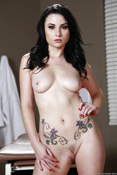 Wiry brunette hair Veruca James demonstrates her worthy tattoos!
