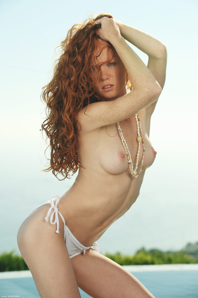 Attractive topless redhead outside