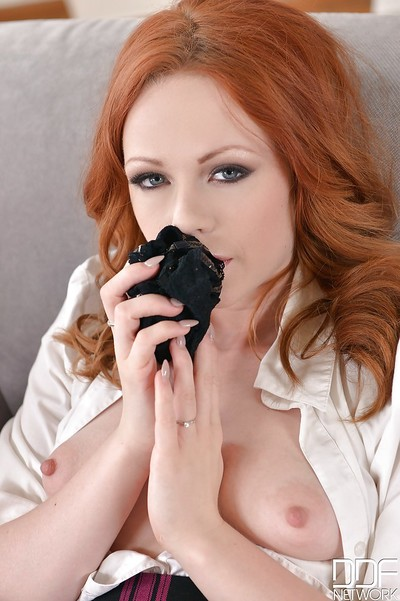 Redheaded schoolgirl Ella Hughes stroking in high heels and knee socks
