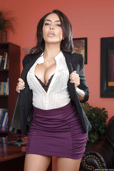 Dark brown dear Lela Star shows off her enormous breasts at her office