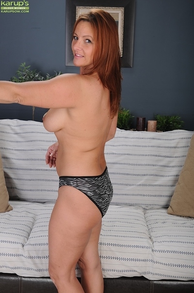 Seasoned hotty with gigantic billibongs Gia Sophia standing in her firm underwear