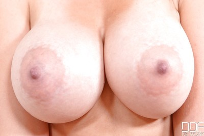Largest tit European bombshell Alex Ebony showing off her admirable love muffins