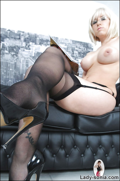 Boobsy fairy queen in glasses posing in nylons on the bed
