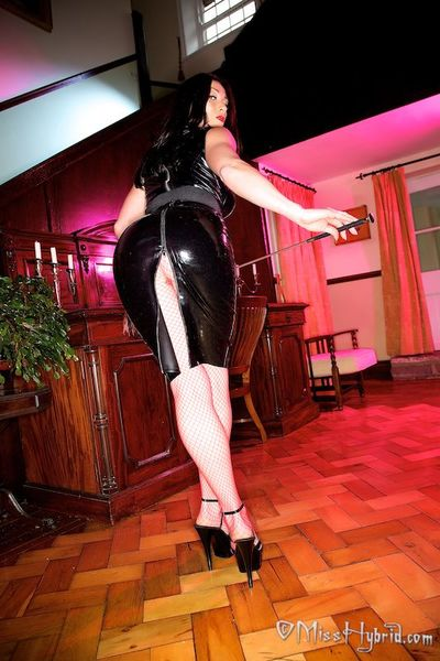 A tough nippled Miss Hybrid wearing latex