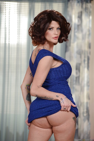 Tall and tattooed mother Joslyn James posing enormously covered in desire costume