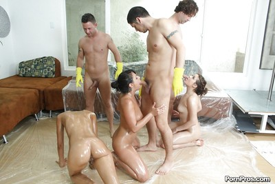 Sexual strippers getting oiled up and screwed in a orgy