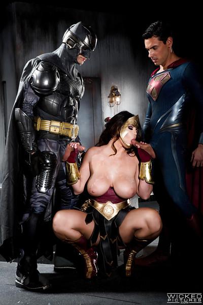 Buxom pornstar Alison Tyler giving Batman and Superman blowjobs