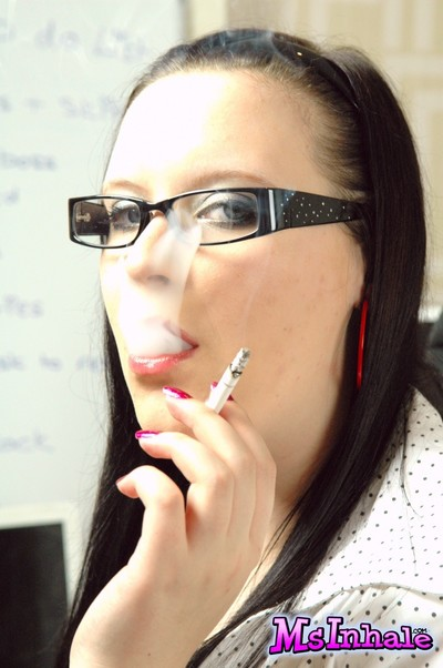 Youthful secretary in glasses very a larger quantity 120 cigarette at plow up