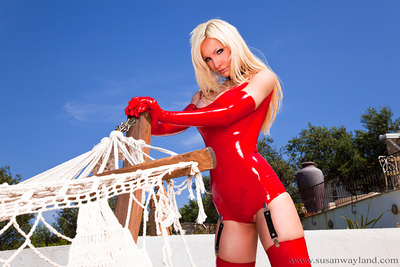 Susan Wayland in this untamed red latex swin clothing with suspenders! 65 burning moist latex pictures.