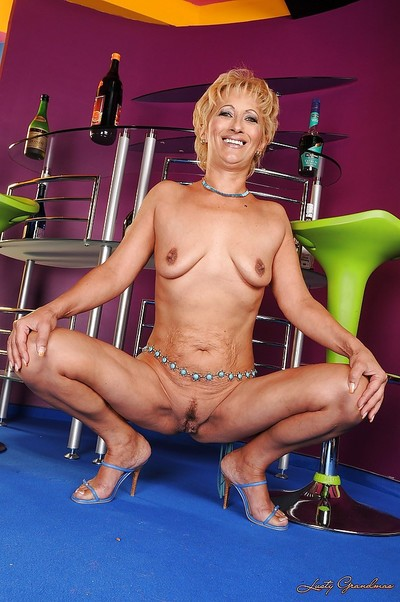 Short haired ripe golden-haired on high heels lovely off her suit and underclothes