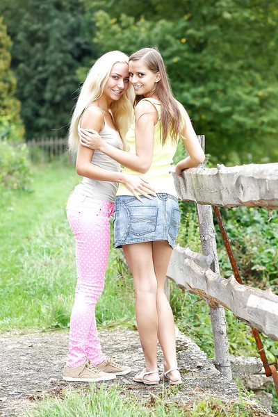 Victoria and Connie have a girl-on-girl outdoor giving a kiss and humping