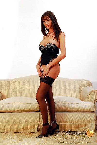 Glamorous dick-holding ladies Mariana Cordoba posing solo in nylons and high heels