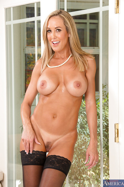 Elegant fairy cougar in  undressing and exposing her goods