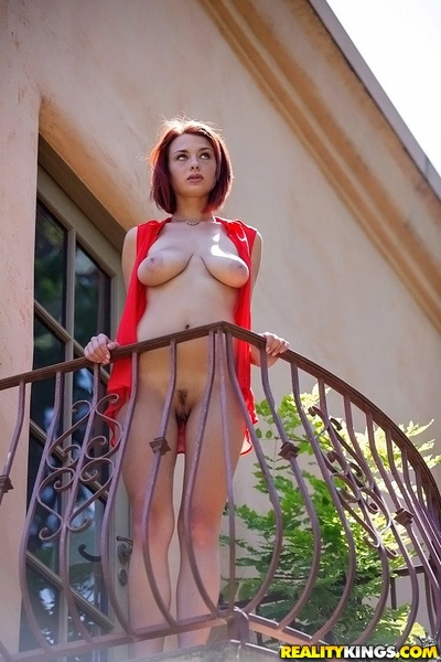 Redhead darling with tremendous ample woman passports performs a posing scene