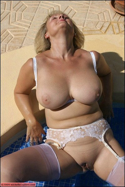Ripe blonde in white sexy pants and  posing and jerking off in the pool