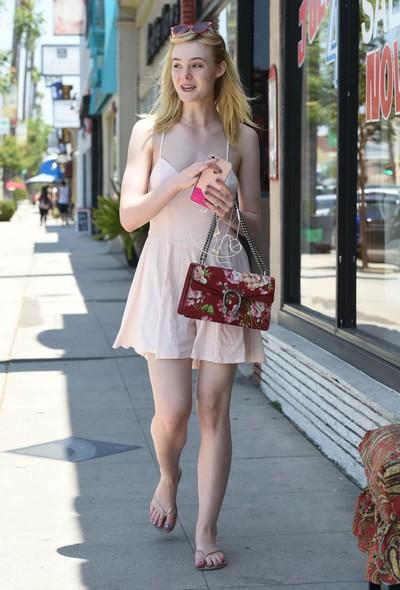 Elle fanning showing pokies in a miniature pink sundress