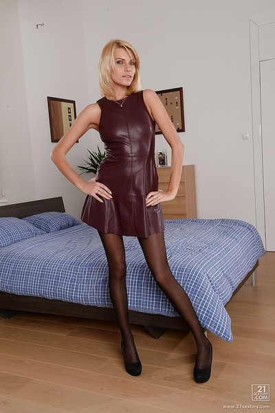 Lean fairy Lana Roberts is jolly off her rigid leather clothing