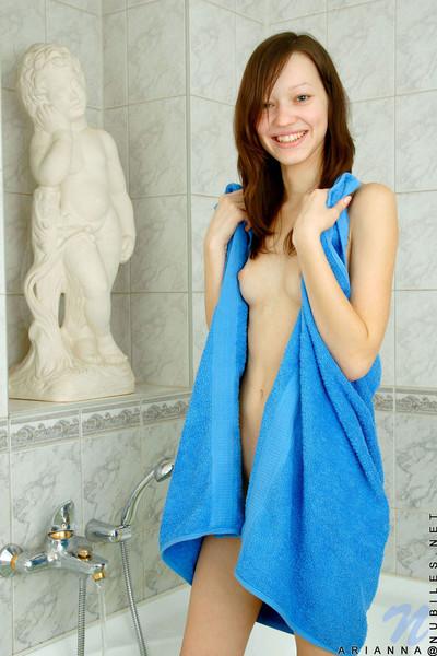 Wiry redhead adolescent bathing
