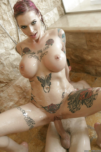 Moist redhead Anna Bell Peaks showing off tattoos and biggest boobs in shower-room