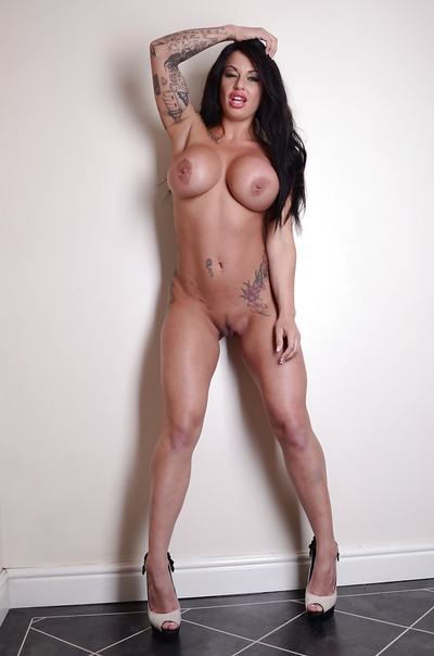 Fixation dark brown Kerry Louise shows off her elegant tattooed body