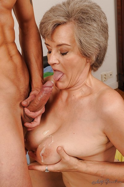 Passionate elderly with gigantic slag jugs gives a cocksucking and purchases penetrated
