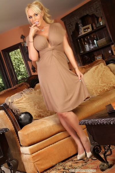 Marvelous golden-haired pornstar, Mary Carey, is all dolled up in her attractive dress. That babe adores the superficial access it gives her to pop out her giant woman passports and show off her smooth pussy.