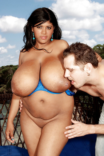Ebon fatty Kristina Milan takes off lacy underwear to take part in with her massive milk shakes