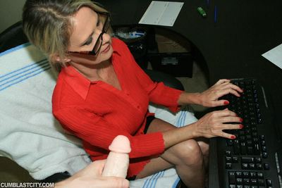 Completely dressed mellow fairy in glasses gives a hand job and purchases bukkaked