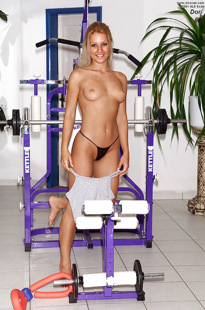 Sporty adolescent golden-haired erotic dance and toying her pussy in the gym