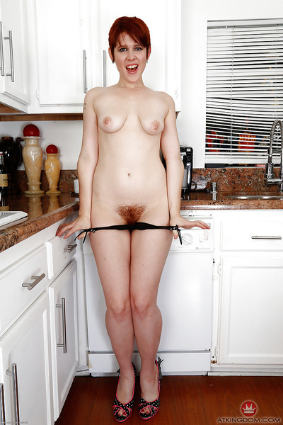 Short haired established redhead MILF Lily Cade stretching wavy pussy in kitchen