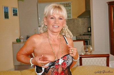 Golden-haired full-grown with a unyielding a-hole drops underwear to show her curly snatch
