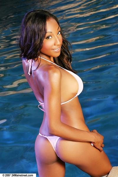 Outdoor posing at the pool features dark hair ebon pornstar Alanna
