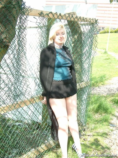 Juvenile golden-haired exhibitionist yanus goes for a walk in her local