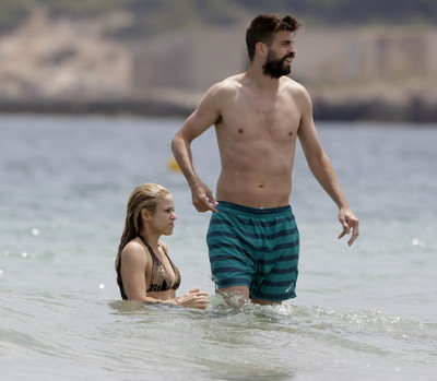 Shakira in a skimpy belt bikini at the beach