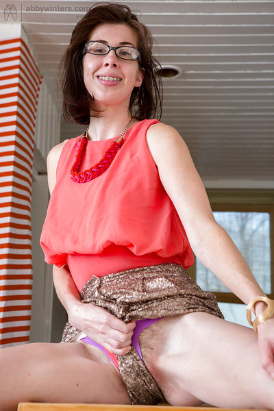 Mature nerd Bonnie C flashing curly upskirt muff for close ups