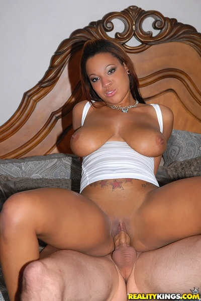 Sexually aroused black angel Natasha Dulce gives a titjob and benefits from bawdy cleft play with tongue