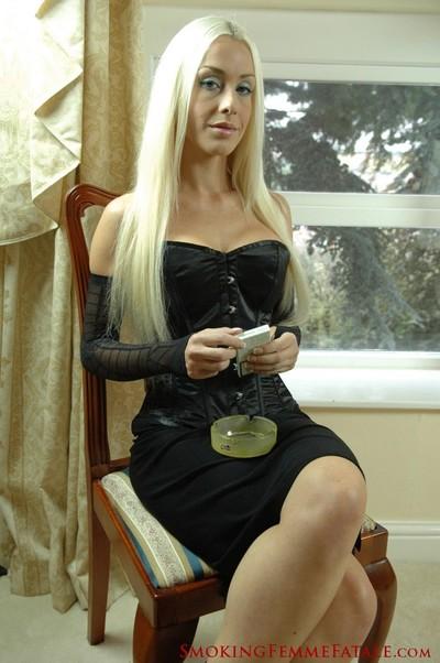 Michelle monroe smokes a 120mm cigarette in ebony corset