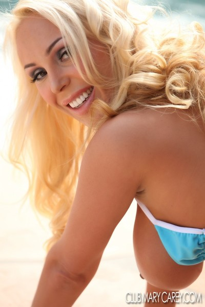 Golden-haired princess Mary Carey gets undressed off her bikin showing her tan clammy body.