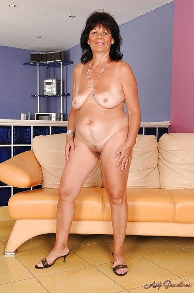 Large full-grown with bendy jugs Helena May striptease and swelling her legs