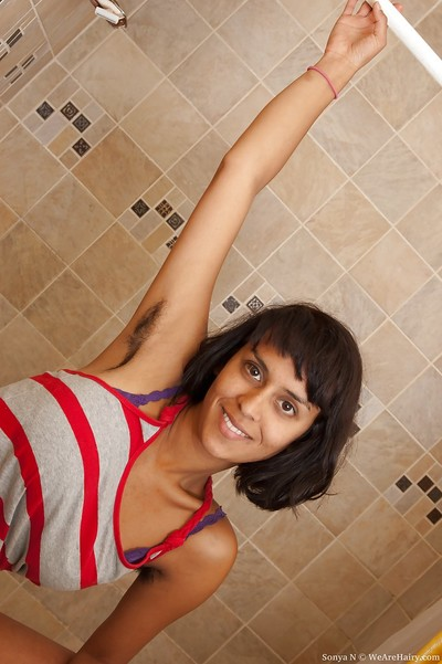 Very perspired Indian lass with bushy armpits Sonya N erotic dance in the washroom