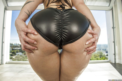 Tattoo sample Dollie Darko flaunts her huge corpulent arse outdoors