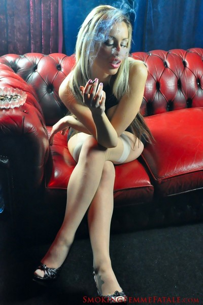 Michelle monroe smokes a cigarillo and shows off her huge breas