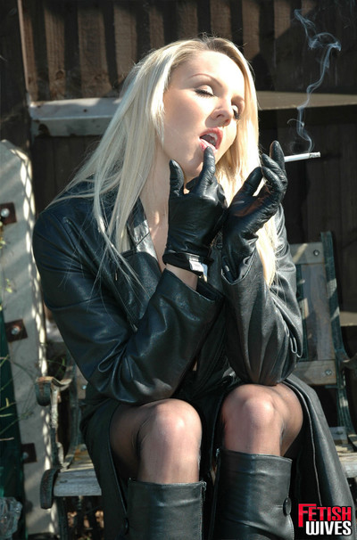 Danni unbuttons her leather dom and smokes
