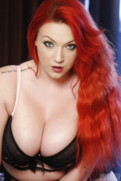 Rounded redheaded Euro queen Harmony Reigns baring giant apples and tattoos