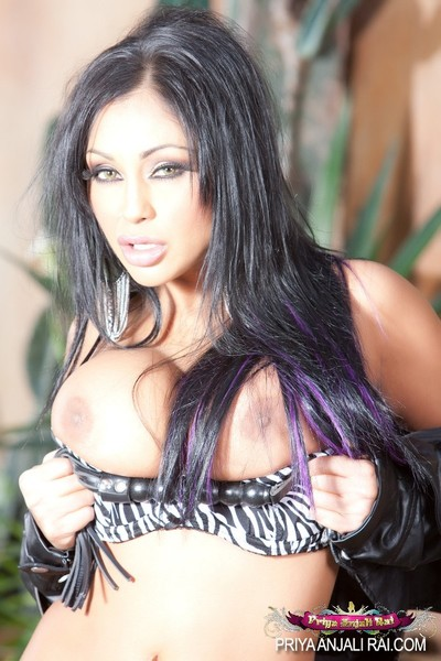 Perspired Indian babe, Priya Anjali Rai, is a sexy woman erotic dancing with no her leather jacket, zebra-print brassiere and thong. This girl looks so moist showing off her vast mangos and alluring body!