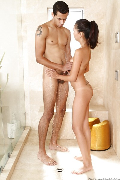 Eastern masseuse gives some soapy hand and fellatio gratification to her hung client