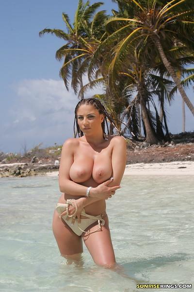 Titsy pornstar Roberta Misoni brings out her puffy mangos from bikini