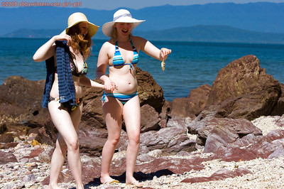 Lesbian babes Chloe B and Sue-Ann strip off their bikinis at the beach